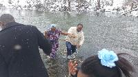 Coming out of the water from a winter baptism #2